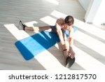 muscular man stretches at the...   Shutterstock . vector #1212817570
