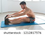 muscular man stretches at the...   Shutterstock . vector #1212817576
