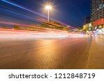 light trails on city street ... | Shutterstock . vector #1212848719