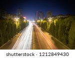 light trails on city road  busy ... | Shutterstock . vector #1212849430