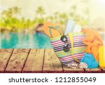 bag  sunglasses  on a... | Shutterstock . vector #1212855049