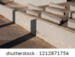 concrete seats in the town of... | Shutterstock . vector #1212871756