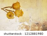 three dry yellow roses on old... | Shutterstock . vector #1212881980