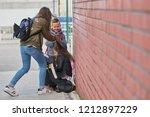 schoolyard bullies  later...   Shutterstock . vector #1212897229