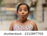 portrait of a girl with a piece ...   Shutterstock . vector #1212897703