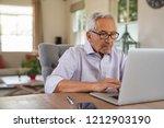 senior man working with laptop...   Shutterstock . vector #1212903190