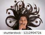 close up of smiling girl lying... | Shutterstock . vector #1212904726