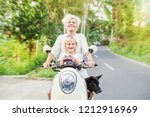 cute mother and daughter riding ...   Shutterstock . vector #1212916969