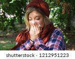 woman portrait outdoor sneezing ... | Shutterstock . vector #1212951223