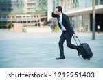businessman running and late... | Shutterstock . vector #1212951403