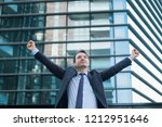 businessman celebrating rising... | Shutterstock . vector #1212951646