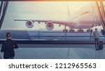 the aircraft is parked at the... | Shutterstock . vector #1212965563