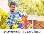 young indian man taking care of ... | Shutterstock . vector #1212994060