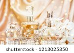glass perfume bottles with... | Shutterstock . vector #1213025350