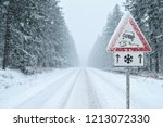 winter driving   heavy snowfall ... | Shutterstock . vector #1213072330