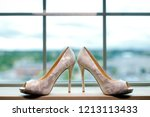 pair of wedding shoes.... | Shutterstock . vector #1213113433