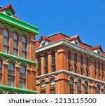 brick buildings featuring large ... | Shutterstock . vector #1213115500