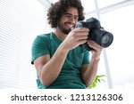photographer reviewing captured ... | Shutterstock . vector #1213126306