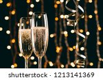 champagne in glasses and... | Shutterstock . vector #1213141369