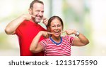 middle age hispanic couple in... | Shutterstock . vector #1213175590