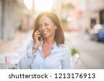 beautiful middle age hispanic... | Shutterstock . vector #1213176913