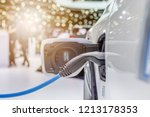 electric vehicle charging... | Shutterstock . vector #1213178353