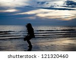 silhouette asian girl on beach   Shutterstock . vector #121320460