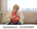 woman having heart attack at...   Shutterstock . vector #1213250569