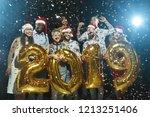 happy friends holding golden... | Shutterstock . vector #1213251406