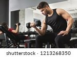 arab muscular man doing biceps... | Shutterstock . vector #1213268350