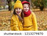 two little girls in autumn park | Shutterstock . vector #1213279870