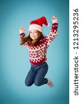 excited christmas girl jumping... | Shutterstock . vector #1213295236