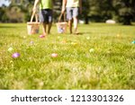 Small photo of easter eggs hunt. Blurred silhouettes of children with baskets in hands. the concept of family fun at Easter. blurred background. Cope space for your text