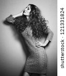 Portrait of beautiful woman in knitted dress. Fashion photo. Curly girl - stock photo