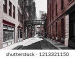 lonely street with sky bridge... | Shutterstock . vector #1213321150