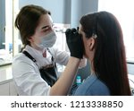 cosmetologist performs the... | Shutterstock . vector #1213338850