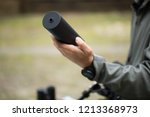 military holds a pistol with a... | Shutterstock . vector #1213368973