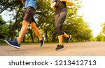 couple runner running outdoor | Shutterstock . vector #1213412713