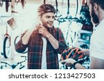 consultant helps guy choose... | Shutterstock . vector #1213427503
