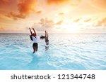 two happy wimen playing in... | Shutterstock . vector #121344748
