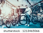 consultant shows bicycle to... | Shutterstock . vector #1213465066