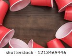 disposable plastic cups on the... | Shutterstock . vector #1213469446