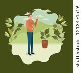 young man planting tree in the... | Shutterstock .eps vector #1213474519
