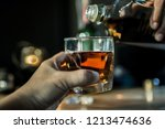 hands of a bartender  with a... | Shutterstock . vector #1213474636