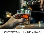 hands of a bartender  with a... | Shutterstock . vector #1213474636