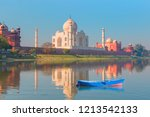 taj mahal with blue wooden boat ... | Shutterstock . vector #1213542133