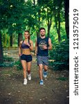 young fitness couple of man and ... | Shutterstock . vector #1213575019