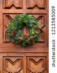 christmas wreath on the carved...   Shutterstock . vector #1213585009