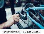 mechanics hand repairing... | Shutterstock . vector #1213592353