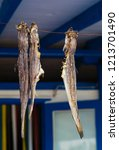 dried fish hanging on a rope... | Shutterstock . vector #1213701490